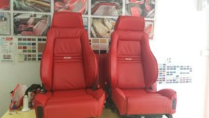 RED LEATHER CAR SEAT UPHOLSTERY